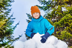 Cute child building snow fortress closeup Royalty Free Stock Photography