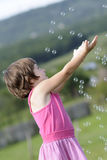 Cute Child Catching Balloons Stock Image