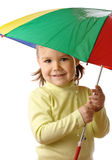 Cute child catching raindrops under umbrella Stock Photo