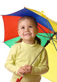 Cute child catching raindrops under umbrella Royalty Free Stock Photos