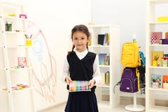 Cute child choosing school stationery. In store royalty free stock photo