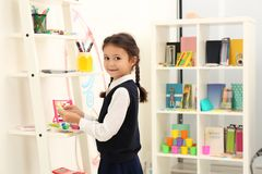 Cute child choosing school stationery stock photography