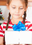 Cute child with a Christmas gift Stock Photo