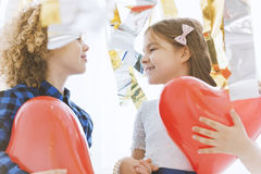 Cute child couple with hearts. Cute child couple with red hearts celebrating valentine`s day Stock Photography