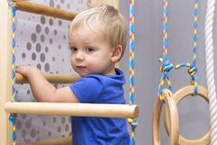 Cute Child crawling on the wall bars royalty free stock photo