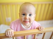 Cute child in crib. Young cute child in crib Stock Photography