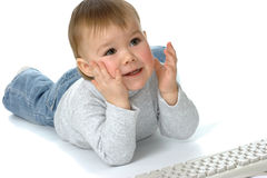 Cute child discussing something near PC. Isolated over white stock photos
