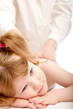 Cute child and a doctor. Massage Stock Photo