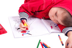 Cute child draw. With color crayons isolated over white stock photo