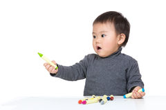 Cute child draw with color crayon. Isolated on white royalty free stock photography