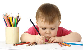 Cute child draw with color crayons. Isolated over white Royalty Free Stock Image