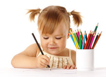 Cute child draw with color pencils. Isolated over white stock photo