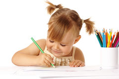 Cute child draw with color pencils and smile. Isolated over white stock photo