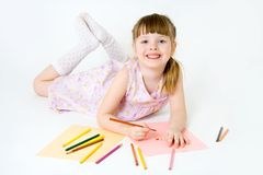 Cute child draw with colorful crayons and smile Stock Photography