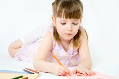 Cute child draw with colorful crayons and smile Royalty Free Stock Photos