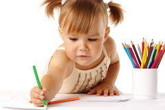 Cute child draw with crayons. Cute child draw with colorful crayons and smile, isolated over white royalty free stock images