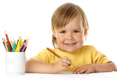 Cute child draw with crayons and smile. Isolated over white royalty free stock photo