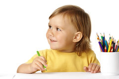 Cute child draw with crayons and smile Stock Images