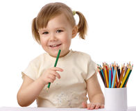 Cute child draws with color pencils Royalty Free Stock Image