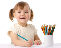 Cute child draws with color pencils Stock Photography