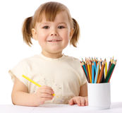 Cute child draws with color pencils Stock Images