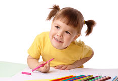 Cute child draws with felt-tip pens Stock Photo