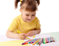 Cute child draws with felt-tip pens Stock Images