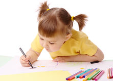 Cute child draws with felt-tip pens Royalty Free Stock Photo