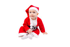 Cute child dressed as Santa Claus. And sitting on the floor isolated on white background Stock Photography