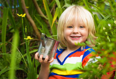 Cute child drinking milk outdoors. Outdoor portrait of a cute chld drinking milk in the garden royalty free stock photo