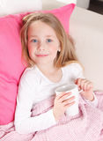 Cute child drinking tea Stock Photo