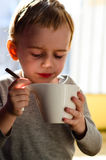 Cute child drinking tea Stock Image