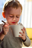 Cute child drinking tea Stock Photos