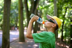 Cute child drinking water Stock Images