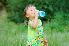 Cute Child Drinking Water Stock Photo