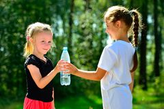 Cute child drinking water from a bottle Stock Photo