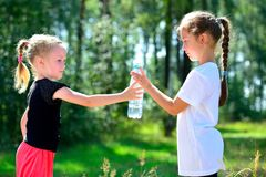 Cute child drinking water from a bottle Stock Photos