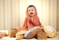 Cute child eating bread Stock Photos