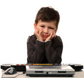 Cute child with electric piano and laptop Stock Image
