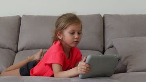 Cute Child Entertaining With Tablet stock video