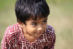 Cute child. A child is in the field Royalty Free Stock Image