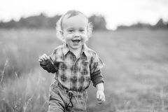 Cute child in a field, happy smiling face Royalty Free Stock Image