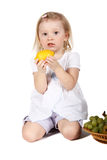 Cute child with fruits Royalty Free Stock Photography