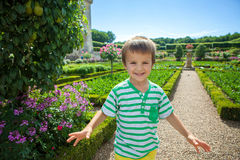 Cute child, in the gardens in front of the Villandry castle on L Stock Photos