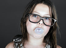 Cute Child Geek Blowing a Bubble Royalty Free Stock Photography