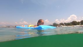 Cute child girl on air mattress in sea. Family vacation concept. Cute child girl on air mattress in sea. Family vacation concept stock video