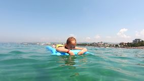 Cute child girl on air mattress in sea. Family vacation concept. Cute child girl on air mattress in sea. Family vacation concept stock footage