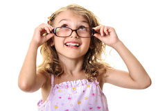 Cute child girl big glasses looking up Royalty Free Stock Image