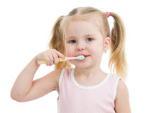 Child girl brushing teeth isolated Stock Photos
