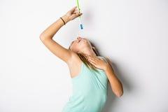 Cute child girl brushing teeth isolated on white background. A cute child girl brushing teeth isolated on white background Stock Photography